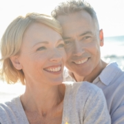 affectionate-mature-couple-embracing-at-the-beach-picture-id986192240